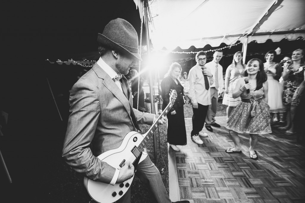 Groom on Guitar at Reception