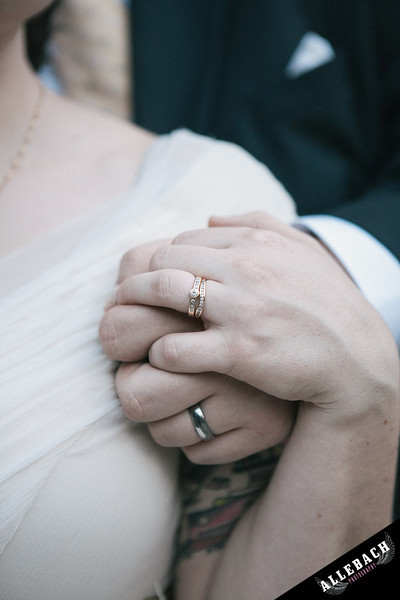 bride and groom rings hands marriage wedding photography by allebach photography