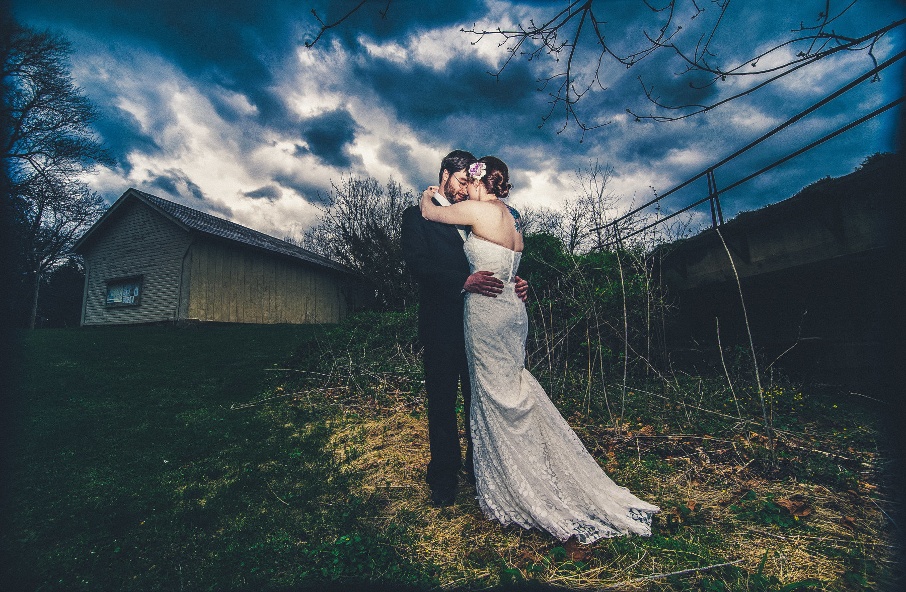 Bride and groom stand next to the Prallsville Mills before a storm on their wedding day.  I photographed this image and soon after saw an Eagle flying above.  It was the first time I saw an Eagle in the wild so it was pretty amazing.  If you are looking for New Jersey wedding photography at the Prallsville Mills give us a call or contact us on the Contact Me page.   To contact the venue use this info: Operated by the Delaware River Mill Society 33 Risler Street Stockton, NJ 08559 T  609-397-3586
