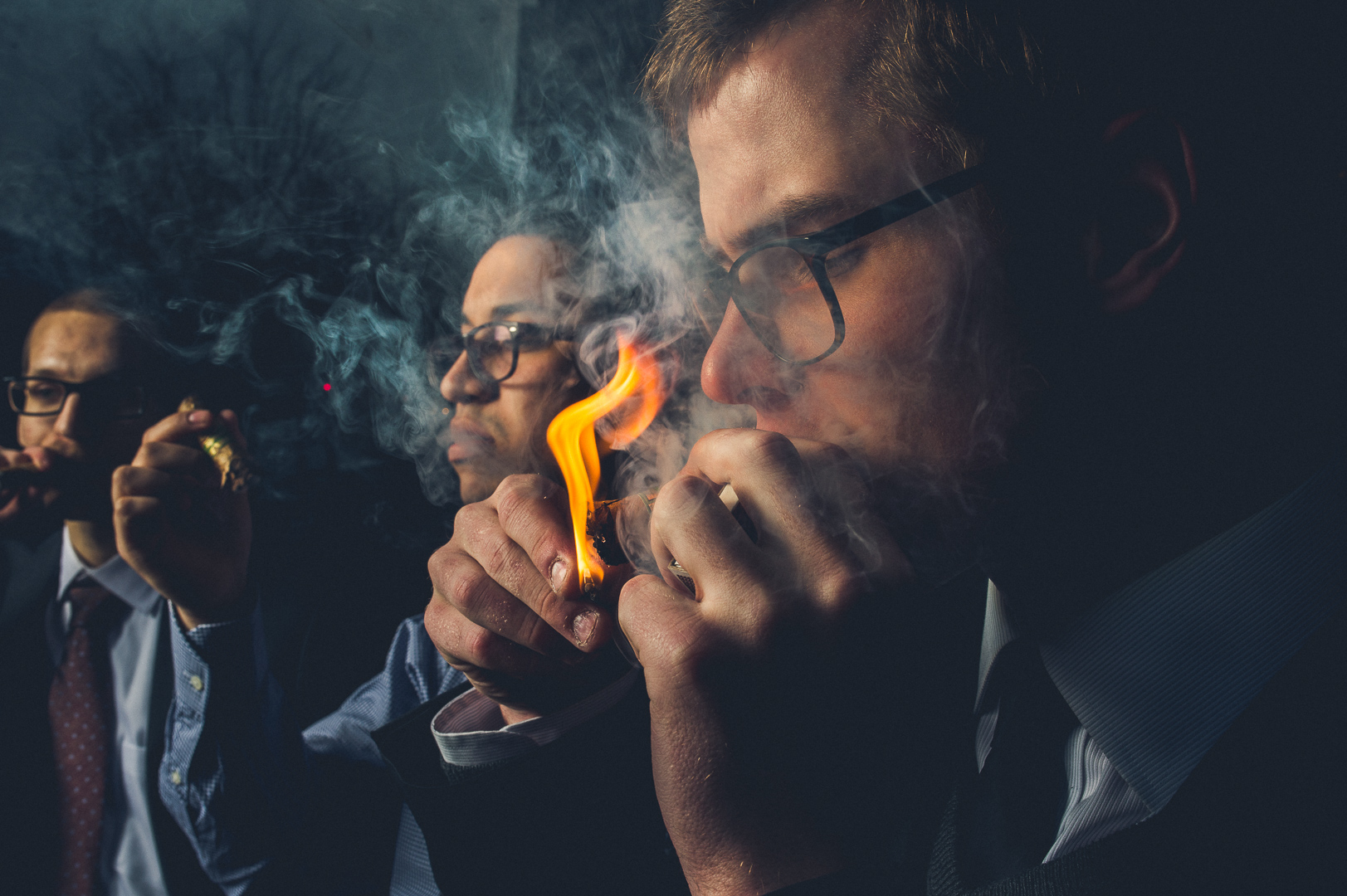 Groomsmen smoking wedding photo