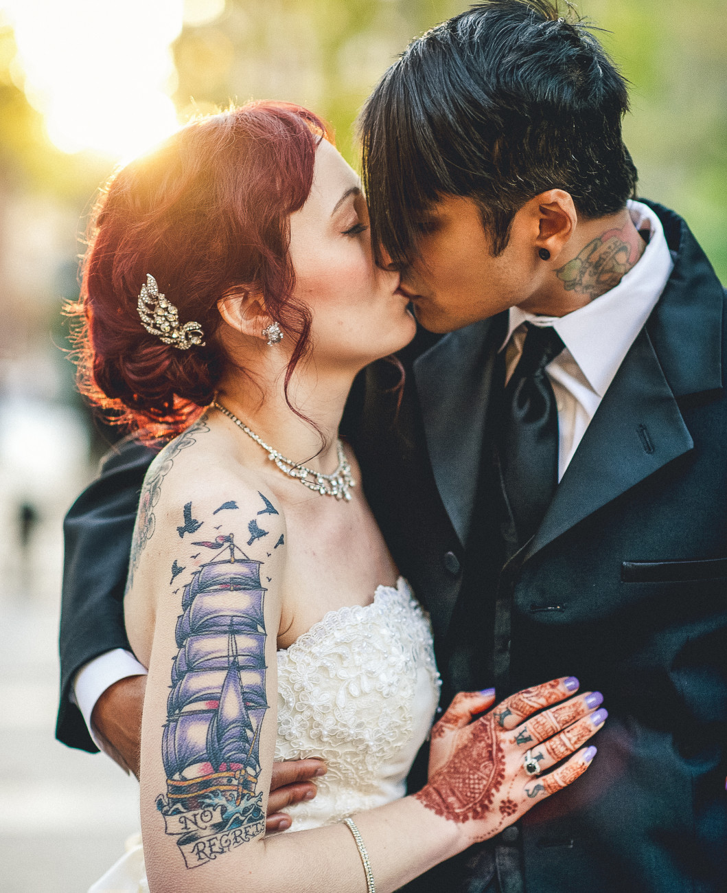 Tattooed Couple Kissing on Their Wedding Day
